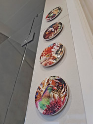 11cm circular ceramic printed wall art tiles with NZ birds & floral background