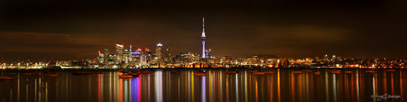 Auckland cityscape showing skyline and reflections by Lucy G, photo art print for sale.