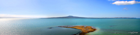 Rangitoto, reef and blue water, landscape photograph from St. Heliers, Auckland - print for sale.