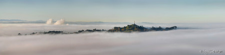 Mist over One Tree Hill photographed from Mt. Eden, Auckland, NZ - print for sale.