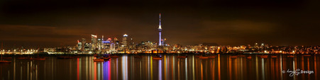 Auckland City Skytower and cityscape with water reflections - landscape photo print for sale.