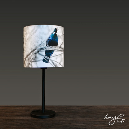 NZ Tui beside lamp base & printed lampshade