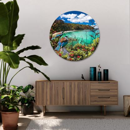 Two Tui birds overlook a picturesque aqua ocean - circular glass or aluminium artwork.