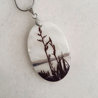 Silhouetted flax pendant necklace.