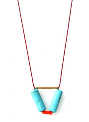 GOLD-PLATED BRASS BAR, MAGNESITE AND VINTAGE ACRYLIC NECKLACE ON RED SILK