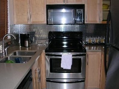 Diamond plate from CutsMetal as a backsplash