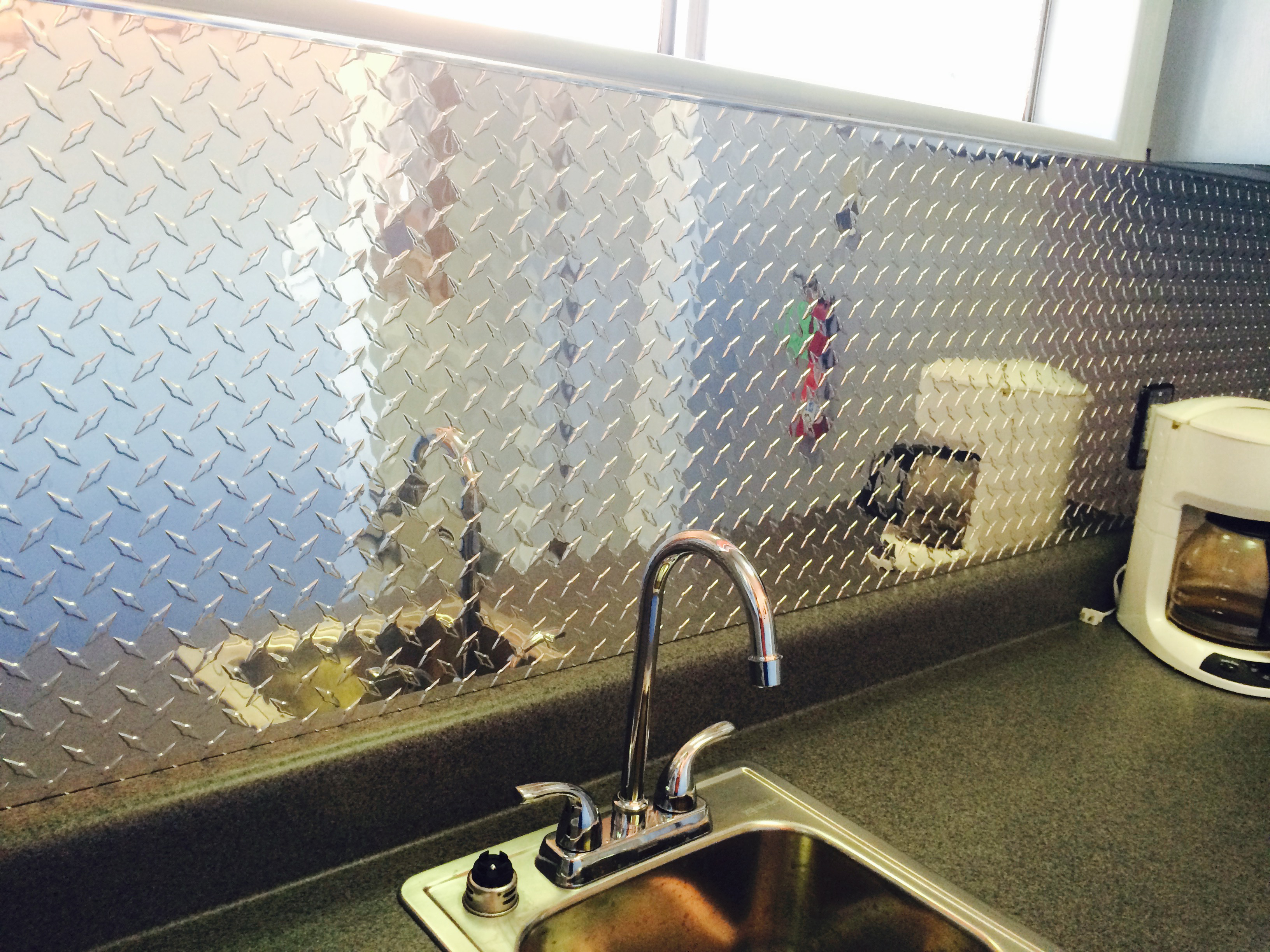 Diamond plate from CutsMetal will make your kitchen look brighter and bigger and will protect from mildew and mold