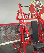 Diamond plate wall panels on a firehouse gym wall.  Polished aluminum sheets give you that reflective clean look.