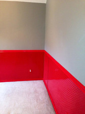 """36"""" Red painted cosmetic grade diamond plate wainscoting.  This is the beginning of a Monster Truck room for a boy.  Can not wait to see the finished product!"""