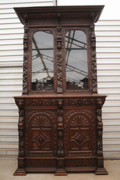 A hand carved in Holland bookcase, display cabinet from the 1890's