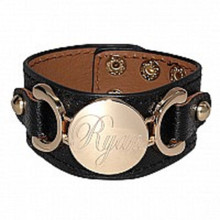 Black leather with engravable disc.