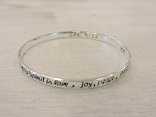Scripture engraved in bracelet