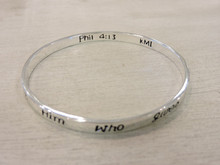 Scripture engraved inside bracelet