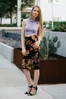The Flora Midi Pencil Skirt is both comfy and chic. It is the perfect knit skirt, with it's bold photo realistic flower print- dressed up or down!  - Cotton and Lycra - Made in the USA   - Knit Midi Skirt  - Photo realistic Floral Print