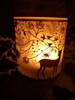 These Danish T-Lite holders give a wonderful Folksy ambience to a Winters night.This is how it looks in a dimly lit room.