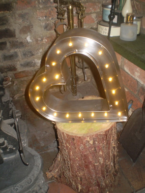 This Stunning Brushed Steel Battery Powered Lamp looks amazing placed on a level Log in an Inglenook Fireplace.