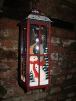 Each side of this gorgeous lantern show a different seasonal scene
