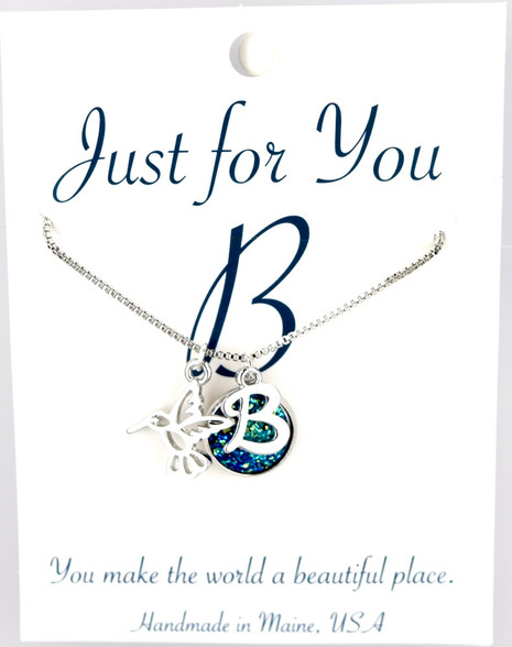"Hummingbird w/ blue colored druzy button.  18"" rhodium plated chain, silver tone.   You choose your own initial in the box below."
