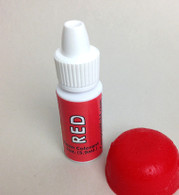 Add just a touch to your epoxy (as little as 0.5%) red colorant, red epoxy pigment