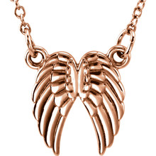 "Tiny Posh Angel Wings 18"" Necklace In 14K Gold measures 10.85x10.25mm and has a bright polish to shine."