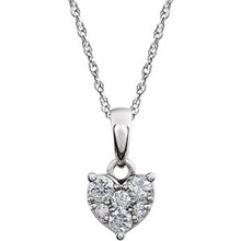 Love is all around and express your romantic side with this heart necklace. This cluster style heart necklace with diamonds set in 14k white gold is a perfect gift for someone you love.