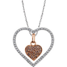 This 14k white gold necklace features a romantic heart adorned with white round diamonds. Diamonds are 1/3ctw, H-J in color, and I2-I3 or better in clarity.