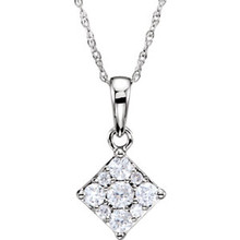 Simple yet stunning, this diamond pendant is a smart look any time. Fashioned in cool 14K white gold, this pendant features nine round-cut diamonds set closely together in a squared frame. A timeless look, this diamond pendant is finished with a bright polish and suspends along a 18.0-inch chain that secures with a spring-ring clasp.