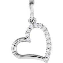 """This 14k white gold 18"""" solid rope necklace features a romantic heart adorned with round diamonds. Diamonds are .07ctw, G-H in color, and I1 or better in clarity."""