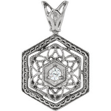 A thoroughly romantic look, dress her neck in vintage style and shimmer! This stunning 14k white gold diamond necklace features an intricate filigree design with milgrain accents. Dazzling diamonds accents add sparkle.