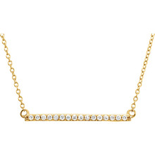 Raise the fashion bar with this elegant and eye-catching necklace. Expertly crafted In 14K yellow gold, this straight bar-shaped design features shimmering sparkling diamonds. A simple-yet-sophisticated look she's certain to adore, this necklace captivates with 1/6 ct. t.w. of diamonds and a polished shine. The look suspends centered along an 18.00-inch chain that secures with a spring ring clasp.