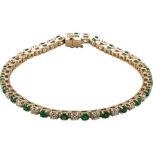 This 14kt yellow gold bracelet features twenty three 3mm genuine and natural green emeralds accented by 23 brilliant cut round near-colorless diamonds of G-H Color and I1 Clarity. The colored precious gemstones and shiny diamonds are set in a prong setting.