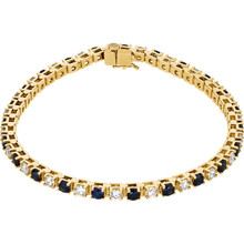 This 14kt yellow gold bracelet features twenty three 3mm genuine and natural blue sapphires accented by 23 brilliant cut round near-colorless diamonds of G-H Color and I1 Clarity. The colored precious gemstones and shiny diamonds are set in a prong setting.