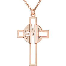 Make your faith personal with this stylish monogram fashion pendant. Created in warm 14K rose gold/sterling silver, this cut-out cross pendant can be customized with the three initials of your choice, sculpted in a bold block monogram font. Enter the initials in the order you would like them, left to right (the center initial will be larger as shown.) Polished to a bright shine, the pendant suspends along an 16.0 or 18.0-inch rope chain that secures with a spring-ring clasp.