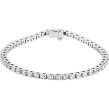 This stunning 14k white gold diamond tennis bracelet is a jewelry box essential with a timeless and classic look that will never go out of style! The bracelet sparkles and shines with 49 round diamonds that are 3 3/8ctw, G or better in color, and I1 in clarity. Bracelet is 7 inches in length.