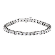 This breathtaking bracelet for her features a brilliant line of round diamonds totaling 9 3/4 carats in weight. The 7.25-inch bracelet is fashioned in 14K white gold and has a bright polish to shine.