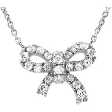 """Show off your feminine flair with this darling diamond bow pendant. Fashioned out of 14K gold and adorned with shimmering 1/6 ct. tw. round diamonds, this graceful necklace comes complete with a matching 18"""" rolo chain. A piece this delicate and pretty can be worn for special occasions or as an everyday accessory."""