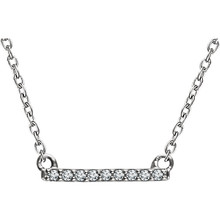 This 14k white gold necklace features a diamond studded bar design. Diamonds are .07ctw, H+ or better in color and I1 or better in clarity. Necklace is 16-18 inches in length with a cable chain. Bar is 12mm in length and 1.5mm in width.