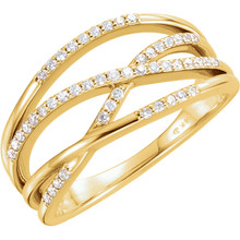 This unique criss cross diamond ring is marvelously crafted in 14k gold. Diamonds are G-H in color and I1 or better in clarity.  With a unique style for her this diamond criss cross ring are unlike any other. Add this fine jewelry item to your collection today.