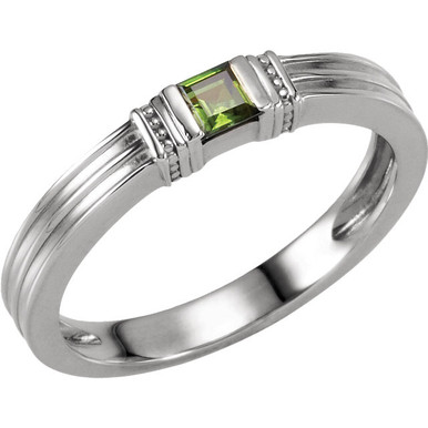 Honor Mom and celebrate family with this unique and modern Mother's ring! Crafted in sterling silver, this traditionally styled ring showcases between one and three princess-cut imitation birthstones you select. Arranged horizontally across the band, these gemstones grab the eye with color and sparkle. See stone chart for options and placement details. This ring is one Mom will choose to wear often.