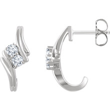 Celebrate your life together with these beautiful diamond two stone earrings. One diamond for your best friend and one diamond for your true love. This two stone diamond design meaningfully represents the dual nature of your bond.