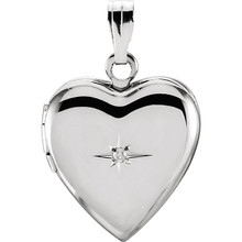 Shimmering style. Featuring a diamond accent, and shiny and satin finishes, this heart locket is simply sleek.