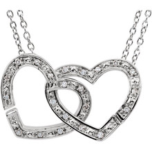 A pair of interlocking hearts swings from this sweet necklace for her. Styled in lustrous 925 sterling silver, the hearts are adorned with diamonds for the perfect touch of brilliance. The pendant has a total diamond weight of 1/6 carat and is suspended from an 18-inch cable chain secured with a spring ring clasp.