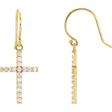 Celebrate faith. The sparkle of this cross pendant emits radiance through prong-set diamonds totaling 1/2 ct. tw. A traditional symbol set in 14K yellow gold.
