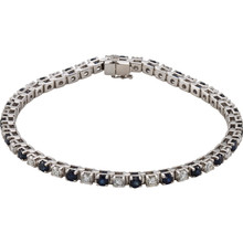 This 14kt white gold bracelet features twenty three 3mm genuine and natural blue sapphires accented by 23 brilliant cut round near-colorless diamonds of G-H Color and I1 Clarity. The colored precious gemstones and shiny diamonds are set in a prong setting.