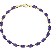 Brightly hued, this genuine amethyst bracelet is crafted in 14k yellow gold and features 18 oval amethyst gemstones.