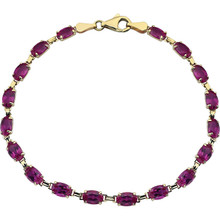 Brilliant oval created rubies set in 14k yellow gold in this eye-catching bracelet.