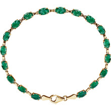 "Brilliant oval created emeralds are set in 14k yellow gold in this eye-catching 7"" bracelet."