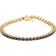 "Striking in design, this petite sapphire 7.00"" bracelet features 46 rich blue sapphires set in 14k yellow gold with a box catch clasp and hidden safety."