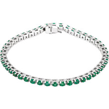 "A dazzling complement to any style, this classic gemstone 7"" bracelet showcases 46 vibrant round shaped emeralds in 14k white gold. Polished to a brilliant shine."