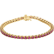 "A timeless classic-look is found in this 14Kt yellow gold 7"" bracelet featuring an array of 3mm rubies."